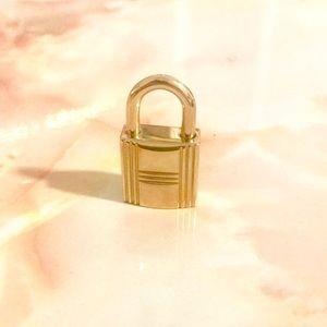 Hermès Cadena lock no key gold metal